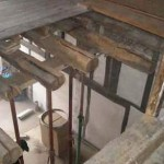 Acrow props supporting the existing joists